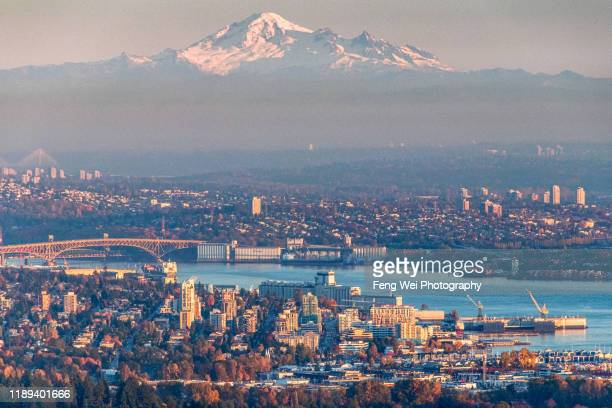 downtown vancouver with mount baker at dusk, british columbia, canada - vancouver skyline stock pictures, royalty-free photos & images