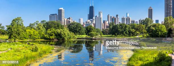 downtown, view of the town with john hancock center skyscraper from lincoln park - image stock pictures, royalty-free photos & images