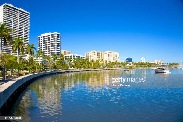Downtown West Palm Beach and curved pedestrian walkway near lagoon