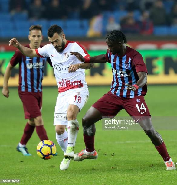 Doye of Trabzonspor in action against Yekta Kurtulus of Antalyaspor during a Turkish Super Lig match between Trabzonspor and Antalyaspor at Medical...
