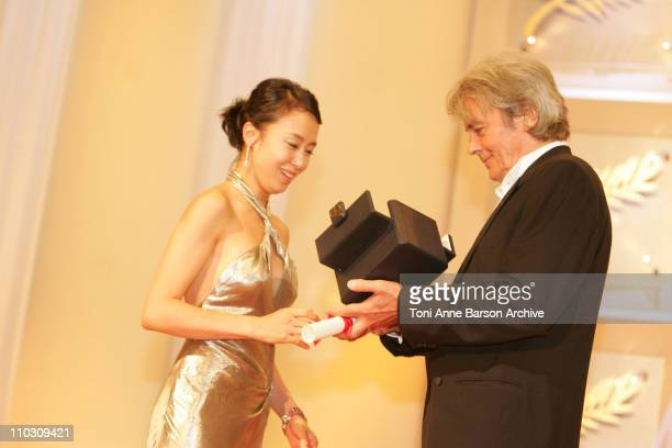 DoYeon Jeon and Alain Delon during 2007 Cannes Film Festival Palme D'Or Ceremony at Palais des Festivals in Cannes France