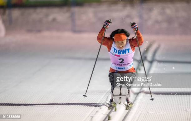 Doyeon Lee at the finish sprint giving all in during the biathlon sprint competition at the Nordic Center Notschrei during the Para Nordic Skiing...