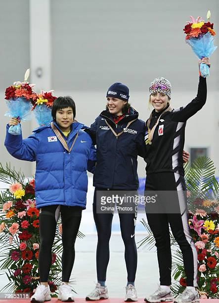 DoYeong Park of South Korea Marrit Leensra of the Netherlands and Nicole Garrido of the Canada pose on the podium with their medals after the Women's...