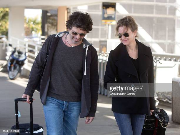 Doyle Bramhall II and Renee Zellweger are seen at Los Angeles International Airport on February 10 2013 in Los Angeles California
