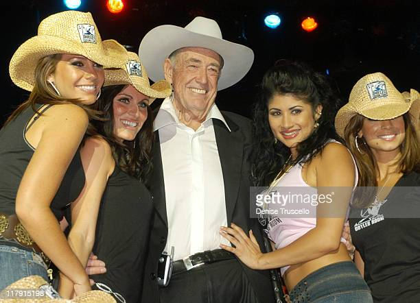 Doyle Brunson with Models during Doyle BrundsonPamela Anderson Party to Launch PamelaPokercom at The Bellagio Hotel and Casino Resort in Las Vegas...