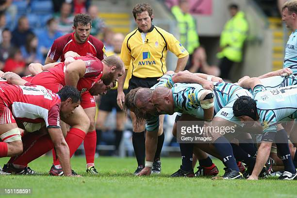 Doyle the referee looks on while the front rows come together during the Aviva Premiership match between London Welsh and Leicester Tigers at the...