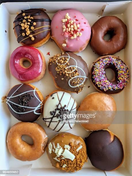 a dozen donuts - dozen stock pictures, royalty-free photos & images