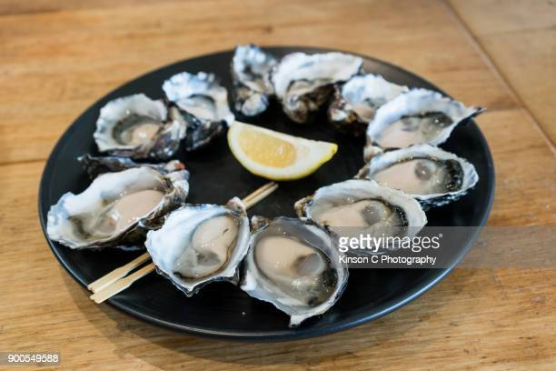Dozen of fresh Tasmanian Oyster on a plate