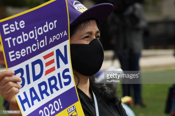 Dozen SEIU essential worker waring mask and hold a sign protested against President Trump during a rally, today on October 01, 2020 at Lafayette Park...