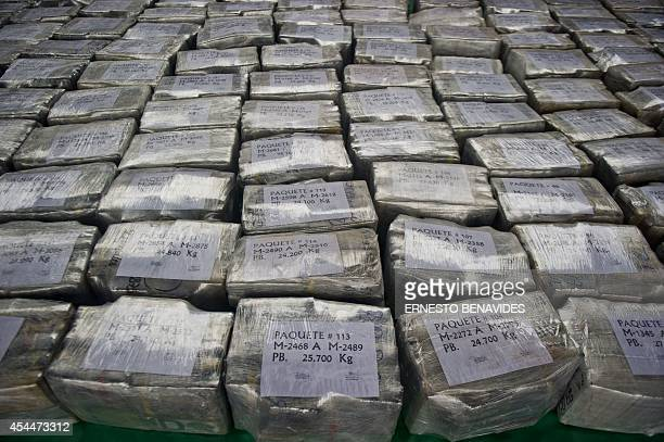 Dozens of 25kgpackages of drug totalizing more than 7 tons of cocaine are presented at the police airport in Lima on September 1 2014 According to...