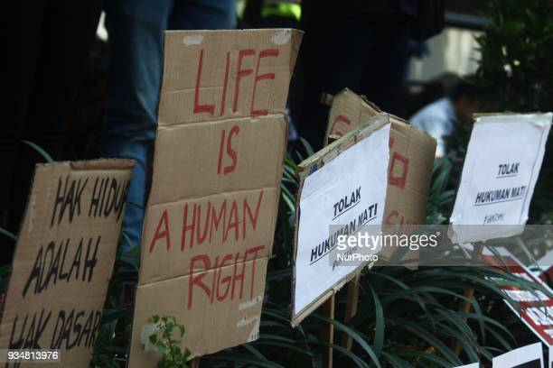 Dozens of activist from Migrant Care organization held a protest outside Saudi Arabia embassy in Jakarta Tuesday March 20 2018 They condemned the...