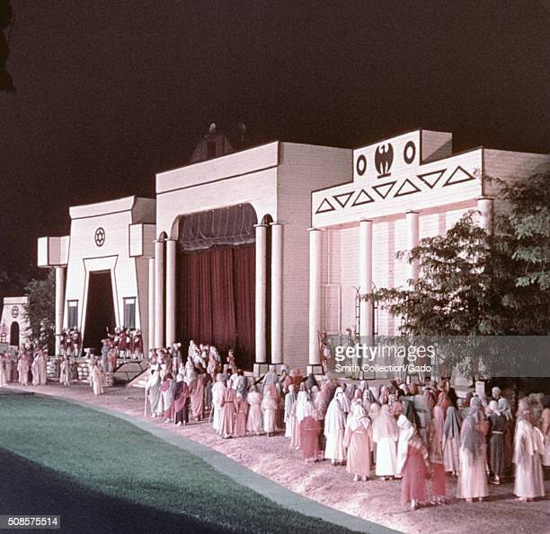 Dozens of actors in period clothing perform in a scene upon an elaborate set depicting a large temple as part of the Black Hills Passion play which...