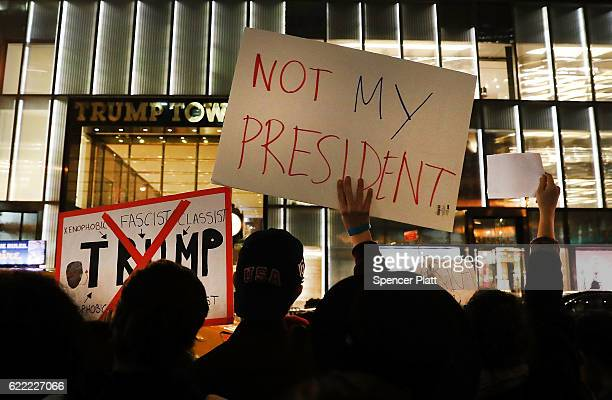 Dozens of antiDonald Trump protesters stand along 5th Avenue in front of Trump Tower as New Yorkers react for a second night to the election of Trump...