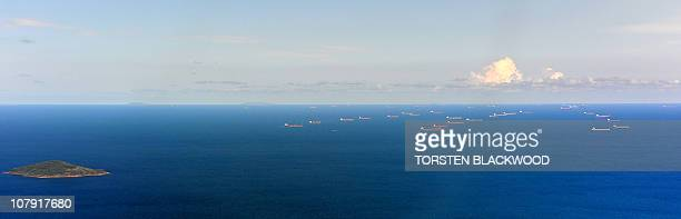 Dozens of bulk carriers anchor off the coast of Mackay on January 7 2011 waiting to be loaded with coking coal The Queensland floods have sent the...