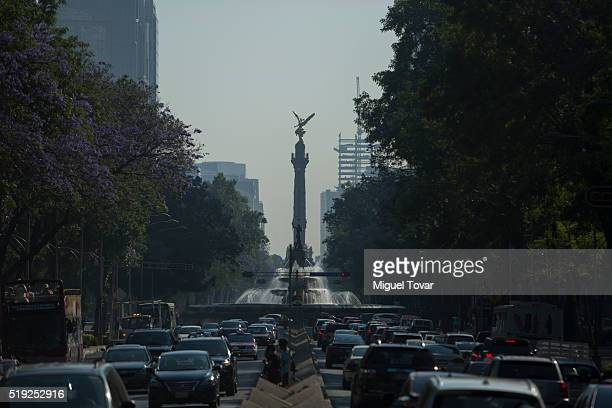 Dozens of cars drive along Reforma Av on April 5 2016 in Mexico City Mexico Authorities have declared a pollution alert after smog rose to one and a...
