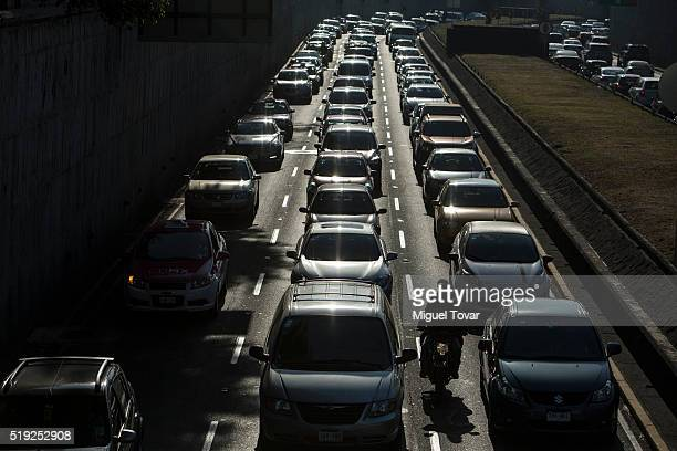 Dozens of cars drive on April 5 2016 in Mexico City Mexico Authorities have declared a pollution alert after smog rose to one and a half times...
