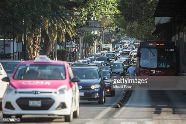 Dozens of cars stuck in a traffic jam on April 5 2016 in Mexico City Mexico Authorities have declared a pollution alert after smog rose to one and a...