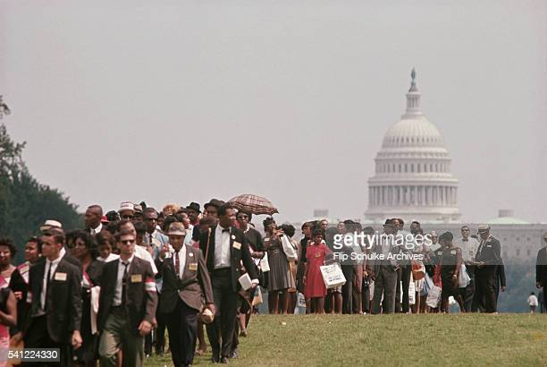 Dozens of civil rights marchers pass the US Capitol on the Mall during the March on Washington