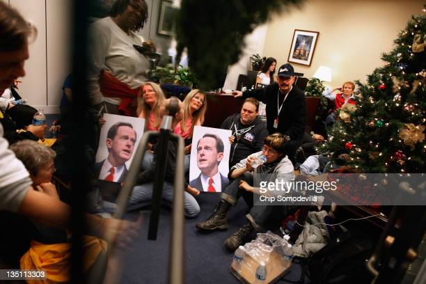 """Dozens of demonstrators from Pennsylvania occupy the office of Supercommittee member Sen. Pat Toomey during the """"Take Back the Capitol"""" protest in..."""