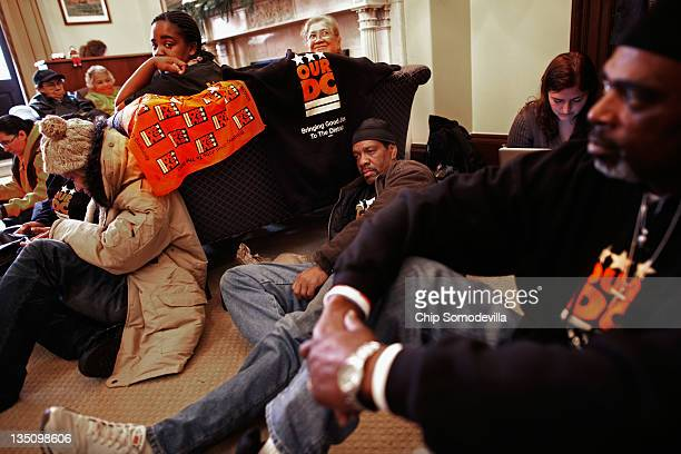 """Dozens of demonstrators from the Our DC group occupy the office of Senate Minority Leader Sen. Mitch McConnell during the """"Take Back the Capitol""""..."""