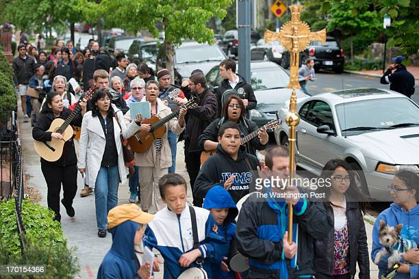 Dozens of evangelizers stroll through 11th Street Northeast singing and playing music as they head to the Benning Road Metro Station to have an...