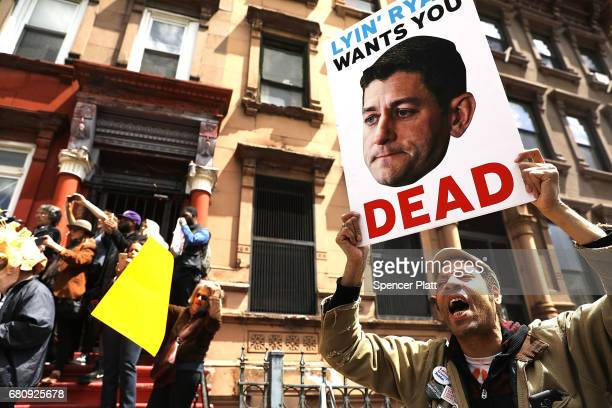 Dozens of health care activists protest in front of a Harlem charter school before the expected visit of House Speaker Paul Ryan on May 9, 2017 in...