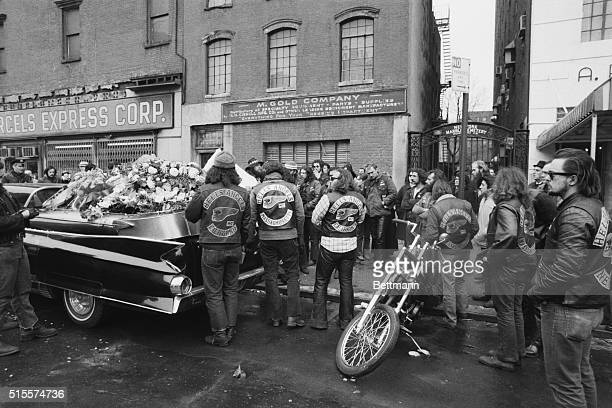 Dozens of Hell's Angels bikers pay a fond farewell to fellow member Jeffrey 'Groover' Coffrey as his coffin slides into a hearse in on the Lower East...
