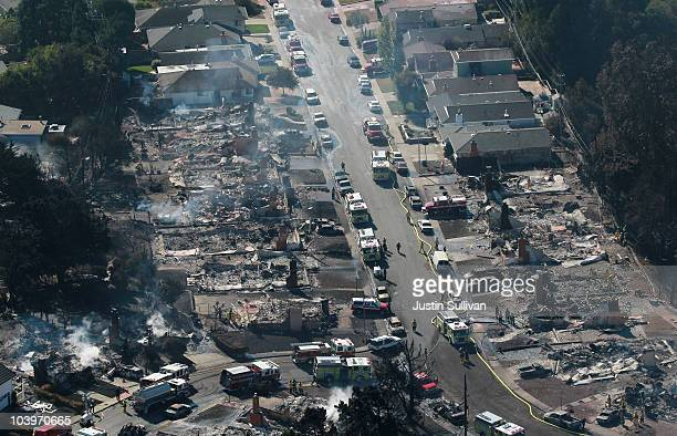 Dozens of homes sit destroyed by a massive explosion and fire September 10 2010 in San Bruno California Thirty eight homes were destroyed and four...
