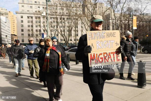 Dozens of immigration activists clergy members and others participate in a protest against the imprisonment and potential deportation of immigration...