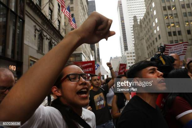 Dozens of immigration advocates and supporters attend a rally outside of Trump Tower along Fifth Avenue on August 15 2017 in New York City The...
