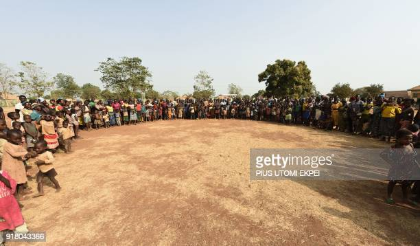 Dozens of internally displaced persons form a circle at the internally displaced people camp occupied largely by women and children affected by...