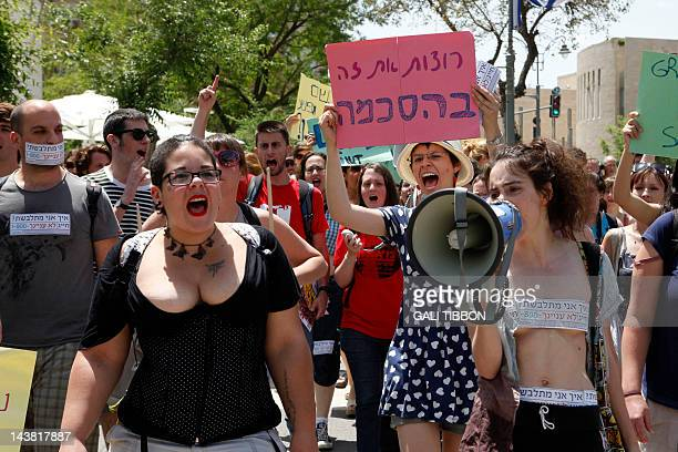 Dozens of Israeli activists chant slogans during a 'SlutWalk' rally in Jerusalem on May 4 2012 to protest sexual violence and counter claims that...