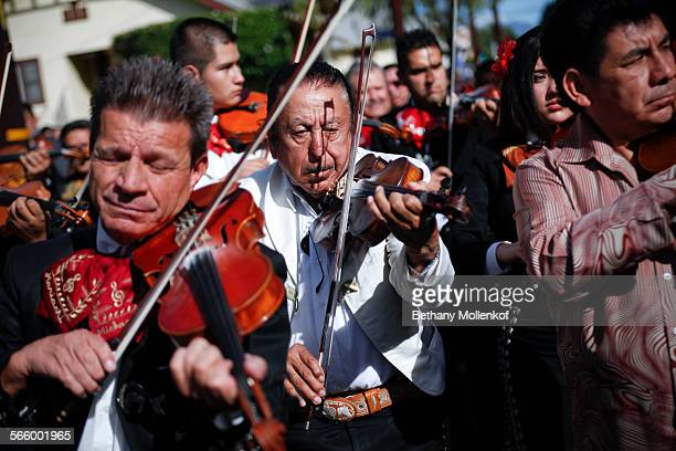 Dozens of Mariachi bands gathered at Mariachi Plaza in Los Angeles to play music and march in a parade in honor of the Catholic patron of musicians...