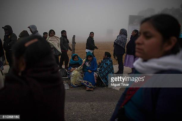 Dozens of Mexican indigenous line up to get into the mass of Pope Francis on February 15 2016 in San Cristobal de las Casas Mexico