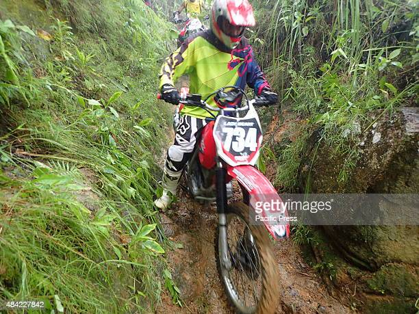 Dozens of motor enthusiasts joins the annual motor trail cross competition in the muddy and steep mountains of Kematu a small scale mining village in...