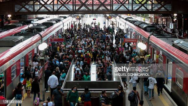 Dozens of passengers walk after disembarking from the train at Luz station in central Sao Paulo, Brazil, on March 5 amid the novel coronavirus...