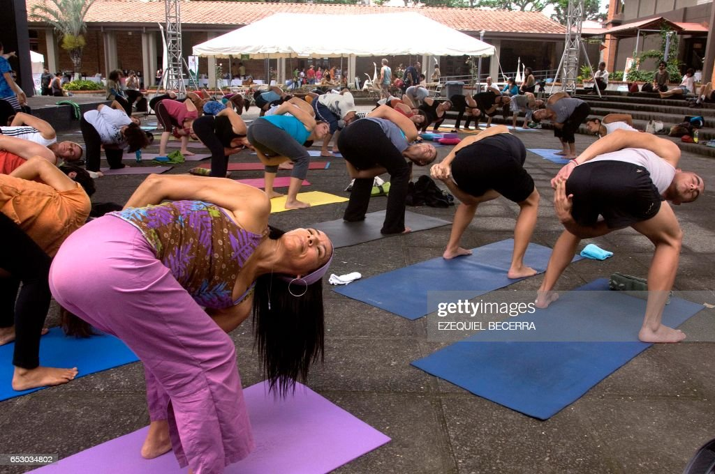 Dozens of people attend a yoga class, as part of the National Yoga Festival at the premises of the Ministry of Culture, in San Jose, on September 10, 2011. AFP PHOTO/Ezequiel BECERRA /