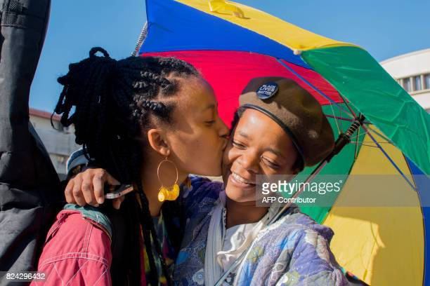 Dozens of people cheer and dance as they take part in the Namibian Lesbians Gay Bisexual and Transexual community pride Parade in the streets of the...