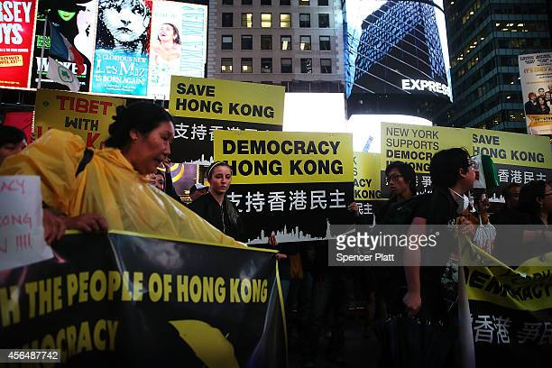 Dozens of people demonstrate in New York's Times Square to show solidarity with pro democracy events in Hong Kong on October 1 2014 in New York City...
