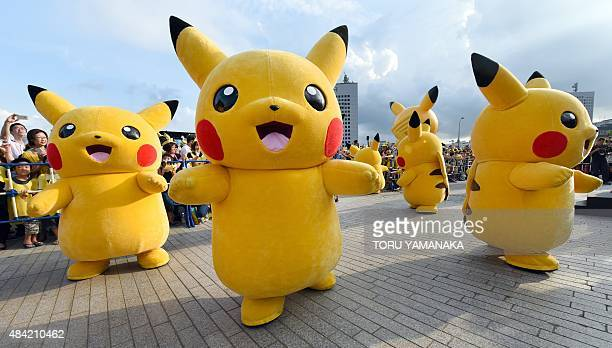 Dozens of people dressed up as Pikachu the famous character of Nintendo's videogame software Pokemon dance with fans as the final of a nineday...