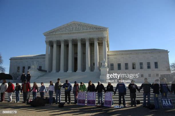 Dozens of people form a circle to share prayer during the March for Life prayer vigil in front of the Supreme court building on January 22 2006 in...