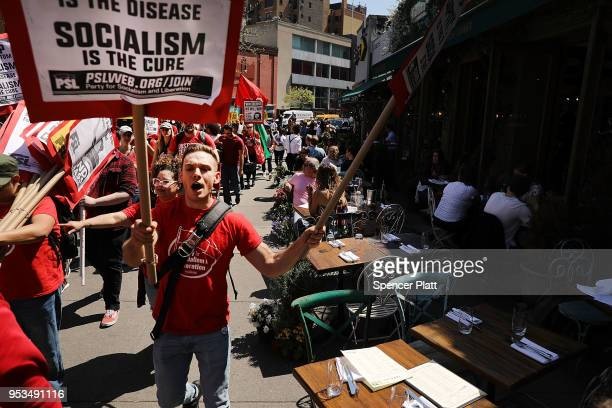 Dozens of people march in May Day protests on May 1, 2018 in New York City. Across the country and world people are protesting, marching and staying...