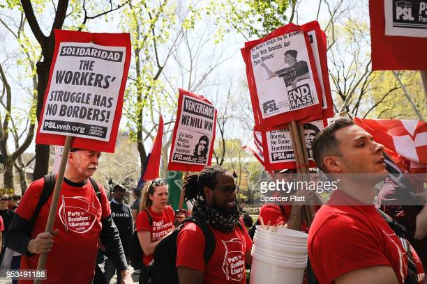 Dozens of people march in May Day protests on May 1 2018 in New York City Across the country and world people are protesting marching and staying...