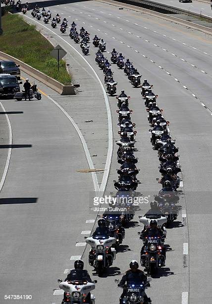 Dozens of police motorcycles lead the funeral procession of slain Dallas police Sgt Michael Smith as it travels to restland Memorial Park on July 14...