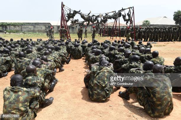 Dozens of recruits undergo training at headquaters Depot of the Nigerian Army in Zaria Kaduna State in northcentral Nigeria on October 5 2017 The...