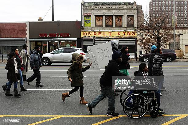 Dozens of residents activists and community leaders participate in a march and rally against violence on December 30 2013 in Newark New Jersey While...