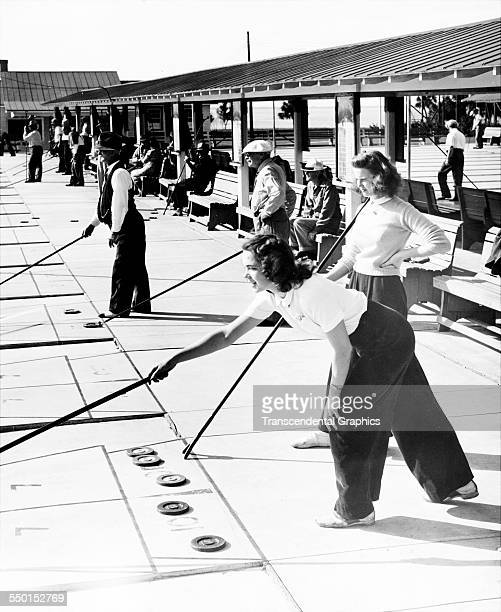 Dozens of shuffleboard players in action at a country club Florida circa 1940