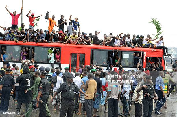Dozens of students of University of Lagos sits on May 30 2012 on a bus on Third Mainland bridge in Lagos to protest the name change of their...
