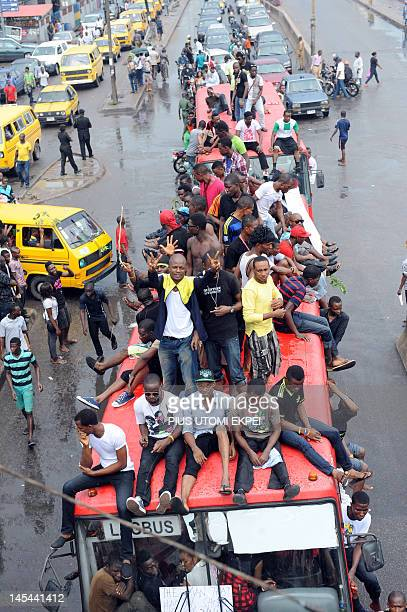 Dozens of students of University of Lagos sits on May 30, 2012 on a bus on Third Mainland bridge in Lagos to protest the name change of their...