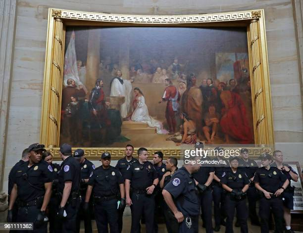 Dozens of US Capitol Police officers gather at the base of the painting 'The Baptism of Pocahontas' before arresting demonstrators taking part in the...
